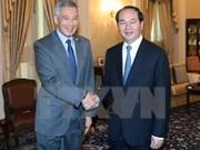 Entrevue entre le président vietnamien et le PM singapourien