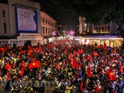 Tourbillon de bonheur à Hanoï après la victoire de l'équipe du Vietnam U23