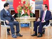 Le président Tran Dai Quang rencontre le président du Parti communiste japonais