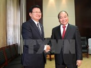 Le PM Nguyen Xuan Phuc rencontre les plus hauts dirigeants laotiens
