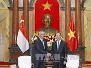 Le président Tran Dai Quang reçoit le Premier ministre Lee Hsien Loong
