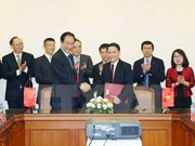 Signature d'un accord de coopération entre VNA et Xinhua