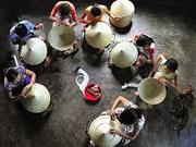 À Hanoi, chapeau (conique) bas au village de Chuông