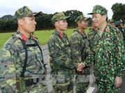 Le président Trân Dai Quang travaille avec le ministère de la Défense