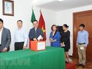 Des Vietnamiens au Mexique aident les victimes laotiennes lors de l'effondrement d'un barrage