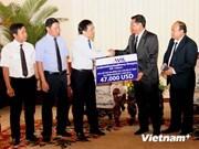 Aide vietnamienne pour les proches des victimes du crash d'un avion au Laos