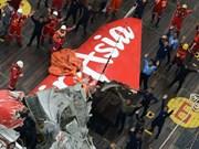AirAsia: l'épave repêchée, chasse aux boîtes noires